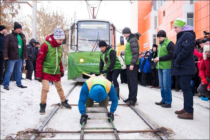 Show Of Strength: Russian Woman Pulls Two Loaded 18-Ton Tram Cars In Record-Breaking Stunt Video