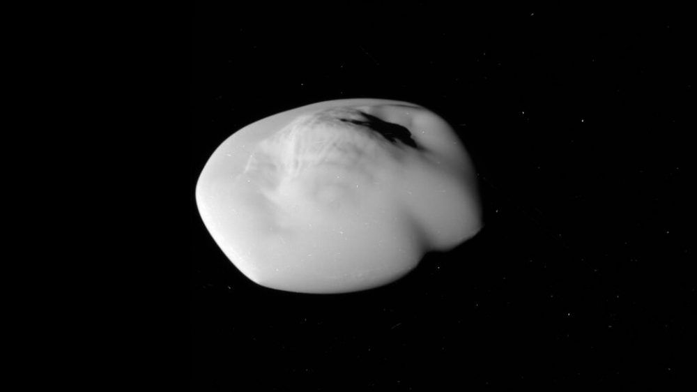 New Photos Show The 'Flying Saucer' Moon Of Saturn In All Its Glory