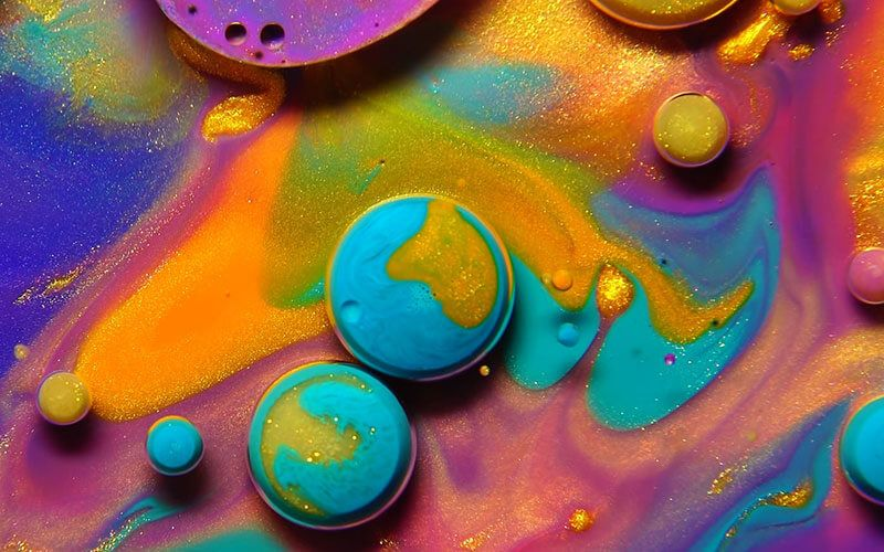 Artists Use Oil, Paint, and Soap To Create Mini Alien Galaxies