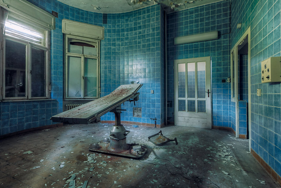 horror operation table in forgotten blue room in a hospital