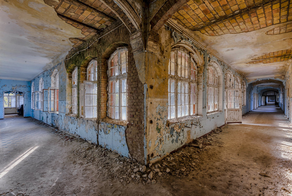abandoned corridor in a hospital with windows and doors