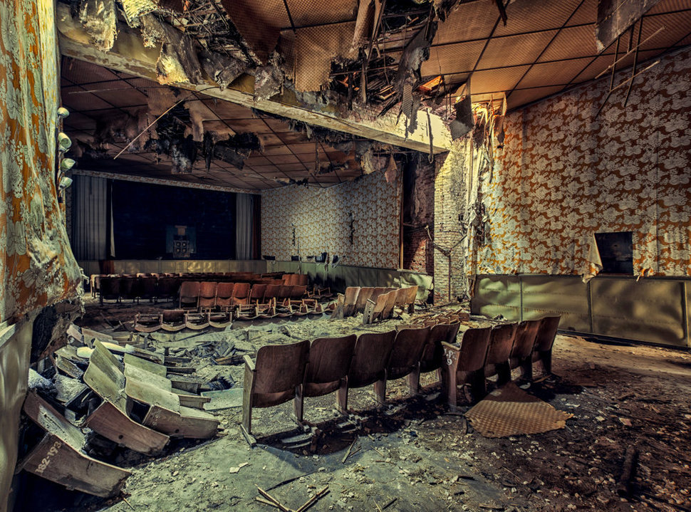 abandoned Cinema with wooden chairs