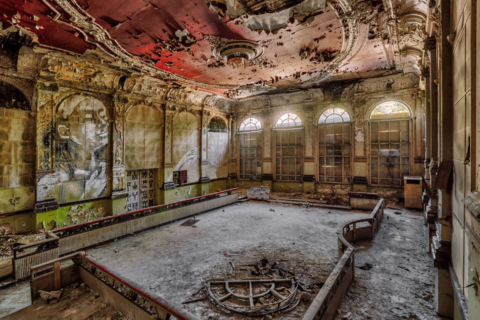 abandoned decay event hall with graffiti and ornament
