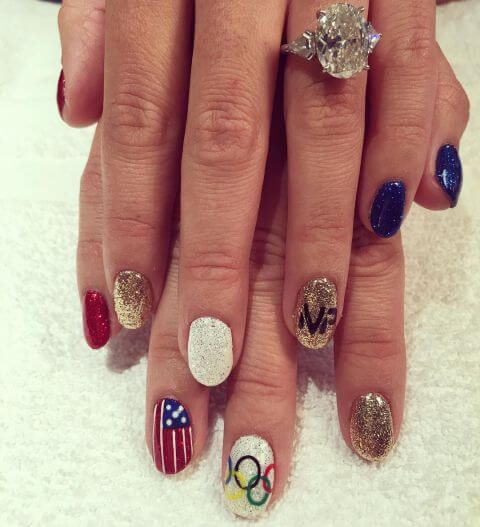 1471290589-elle-olympic-nails-love-this-nail-girl