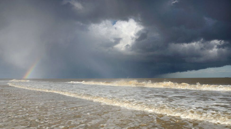 _90689977_jamesbailey-hailstormandrainbowovertheseasofcovehithe