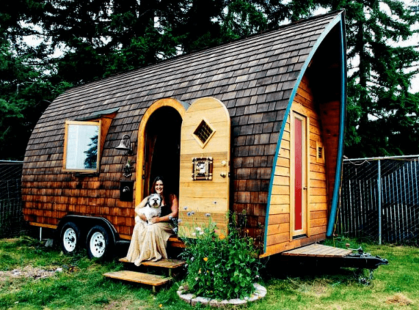 tiny-house-on-wheels-plans-form-curved-walls-the-dominant-brown-wood-with-two-doors-and-a-window-a-very-interesting-and-artistic