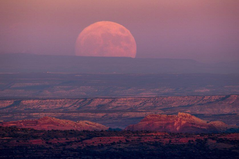 A nearly full moon rises above the Valley of the Gods near Mexican Hat, Utah, on Nov. 13, 2016.
