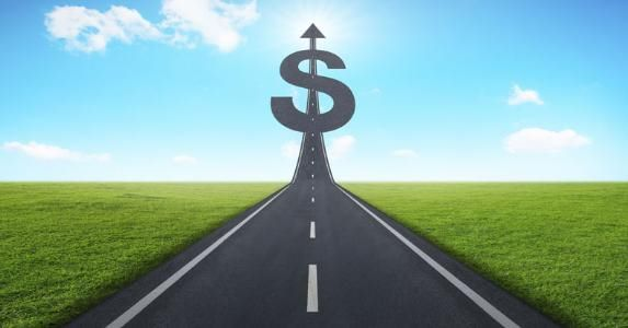 road-heading-toward-a-dollar-sign_573x300